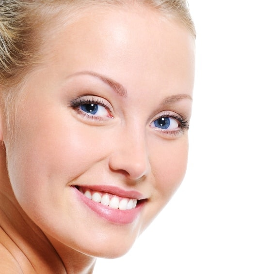 A closeup of a woman's face shows how Juvederm injections help relax certain facial muscles