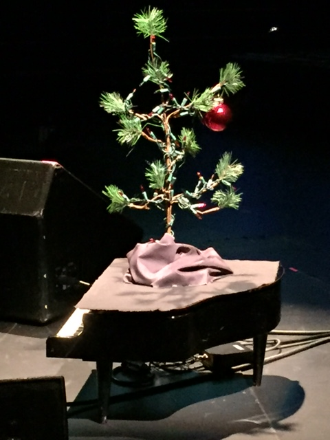 Christmas tree on top of a piano