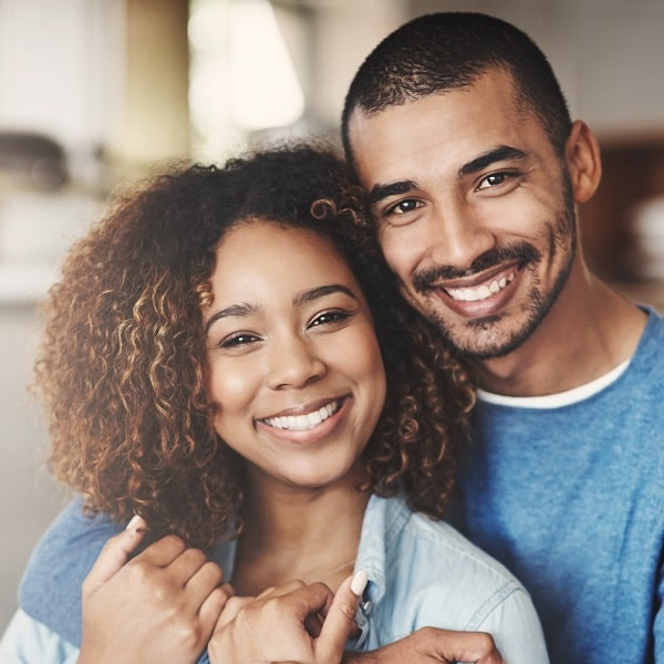 Man and woman with beautiful smiles because of dental bonding.