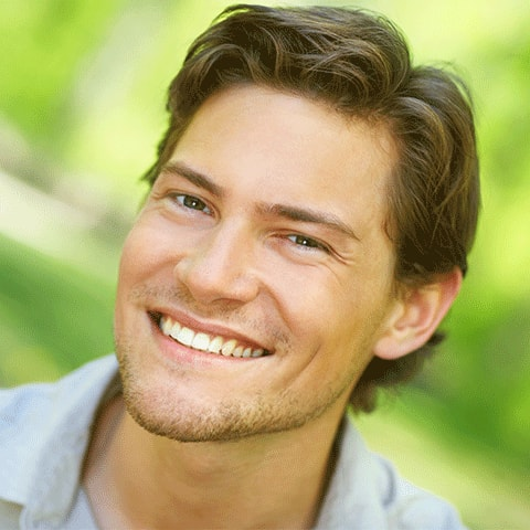 A smiling man illustrates how preventive dentistry can help keep your smile looking it's best.